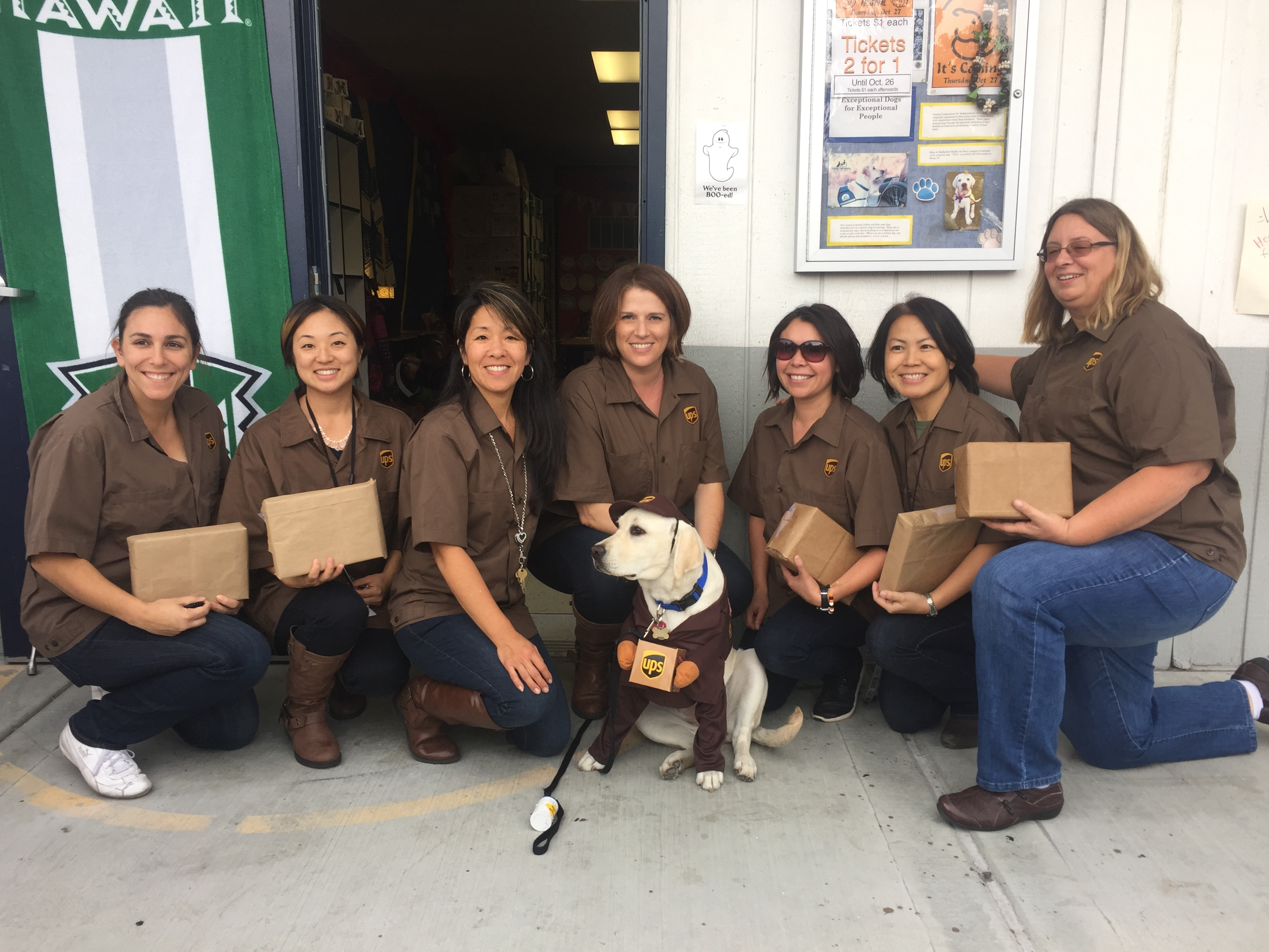 Oria and friends dressed as UPS Carriers on Halloween 2016